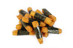 Seaweed wrapped rice crackers on white background Stock Images