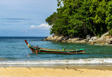 Seaworthy. A fisherman launches his boat after completing repairs on Kata Beach, Phuket, Thailand Royalty Free Stock Image