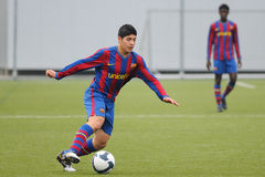 Sebastian de Jesus Leguizamon plays with F.C Barcelona youth team against Gimnastic de Tarragona at Ciutat Esportiva Joan Gamper Royalty Free Stock Photography