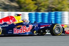 Sebastian Vettel de Red Bull que compite con a las personas Foto de archivo