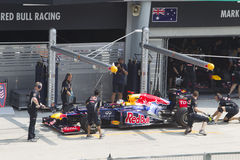 Sebastian Vettel does a trial pit stop Royalty Free Stock Photo