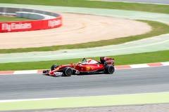 Sebastian Vettel jedzie Scuderia Ferrari samochód na śladzie dla Hiszpańskiego formuła jeden Uroczysty Prix przy Obwodem De Catal Zdjęcia Stock
