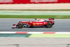 Sebastian Vettel jedzie Scuderia Ferrari samochód na śladzie dla Hiszpańskiego formuła jeden Uroczysty Prix przy Obwodem De Catal Obraz Stock