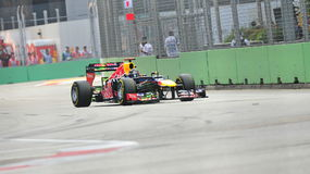 Sebastian Vettel racing in F1 Singapore Grand Prix Royalty Free Stock Photos