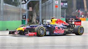 Sebastian Vettel racing in F1 Singapore Grand Prix Royalty Free Stock Images
