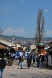 Sebilj fountain and visitors throng Bascarsija bazaar Sarajevo Bosnia Hercegovina Royalty Free Stock Images