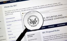 SEC home webpage. MONTREAL, CANADA - NOVEMBER 7, 2017: SEC webpage under magnifying glass. The U.S. Securities and Exchange Commission is an independent agency Royalty Free Stock Image