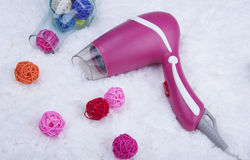 Secador de cabelo cor-de-rosa imagens de stock royalty free