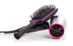 Secador de cabelo e hairbrush foto de stock