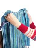 Secador de ropa y mano de la mujer aislada en blanco Fotos de archivo