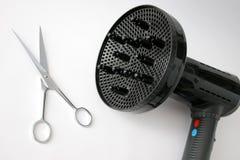 Secador e tesouras de cabelo Fotos de Stock