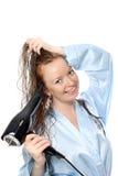 Secagem bonita da menina seu cabelo Imagem de Stock Royalty Free