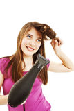 Secagem bonita da mulher nova seu cabelo com secador fotografia de stock royalty free