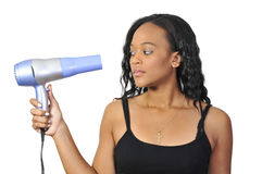 Secagem bonita da mulher seu cabelo Fotografia de Stock