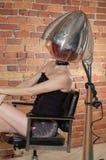 Secagem da mulher seu cabelo fotografia de stock royalty free