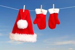 Secagem do chapéu e das luvas de Santa Fotografia de Stock