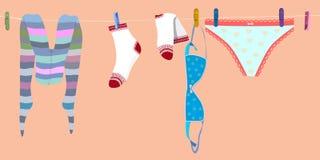 Secagem do roupa interior na corda calças justas, peúgas, calças e sutiã do moderno da mulher Vetor ilustração royalty free