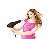 Secagem fêmea Excited seus cabelos com secador fotos de stock