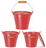 Secchi rossi del metallo su bianco Fotografie Stock