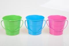 Secchi verdi, blu e rosa Fotografia Stock