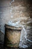 Secchio della pioggia Fotografie Stock