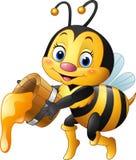 Secchio della tenuta dell'ape del fumetto con la sgocciolatura del miele Fotografie Stock Libere da Diritti