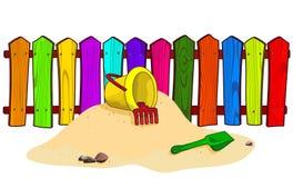 Secchio e pala sulla sabbia Fotografie Stock
