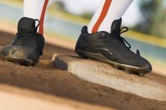Sección baja de un jugador de béisbol foto de archivo