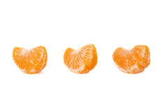 Secciones de la rebanada de la mandarina aisladas sobre Fotografía de archivo
