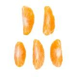 Secciones de la rebanada de la mandarina aisladas sobre Fotos de archivo libres de regalías