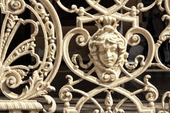 Secession detail of metal historic railing with girl face and ornaments Royalty Free Stock Images