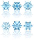 Sechs blaue Schneeflocken Stockfotografie