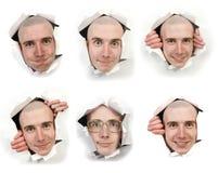 Sechs Gesichter, die durch Löcher schauen lizenzfreie stockfotografie