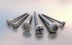 Sechs Metallverschiedene Schrauben neben einander Stockfotos