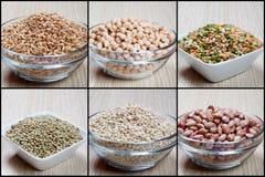 Sechs Schüsseln mit Gemüse und Hülsenfrüchte Lizenzfreie Stockfotos