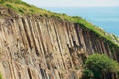 Sechseckige Spalten des vulkanischen Ursprung bei Hong Kong Global Geopark in Hong Kong, China stockfotografie