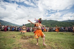 Sechu mask dancing agains the sun at fire and smoke ceremony to cleans of sin in Thangbi Lakhang Stock Image