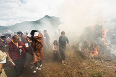 Sechu mask dancing agains the sun at fire and smoke ceremony to cleans of sin in Thangbi Lakhang Royalty Free Stock Image