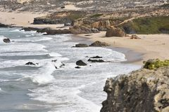 Rocky coastline with sand dunes Alentejo Portugal royalty free stock images