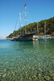 A secluded bay in the Turkish Mediterranean. Traditional Turkish gulet recreational boats anchored at a secluded bay in the Turkish Mediterranean Stock Images