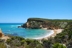 Secluded beach bay. A secluded beach surrounded by cliffs Stock Photos