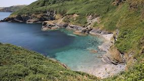 Secluded beach and cove with turquoise sea Cornwall. Secluded beach and cove with turquoise sea Black Head headland St Austell Bay between Porthpean and Pentewan stock video footage