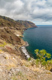 Secluded beach Las Gaviotas and Tenerife coast Stock Image