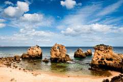 Secluded beach near Albufeira, Portugal. Sandstone rocks in water by the beach near Albufeira, Portugal Royalty Free Stock Image