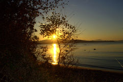 Secluded beach sunset Stock Photos