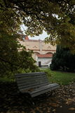 A secluded bench in the autumn Park. Prague, Czech Republic, Europe. Park Vojanovy gardens.Not far from the Charles bridge are Vojanovy gardens (Vojanovy sady Stock Photos
