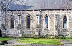 Secluded bench near gothic chapel Royalty Free Stock Photos