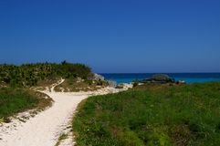 Secluded Bermuda beach. Sandy path leading to secluded beach in Bermuda Royalty Free Stock Photography