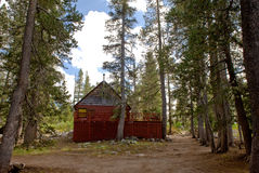 Secluded cabin in forest Stock Images