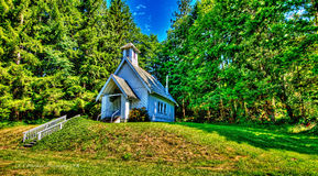 Secluded country church in the pines HDR. Stock Image
